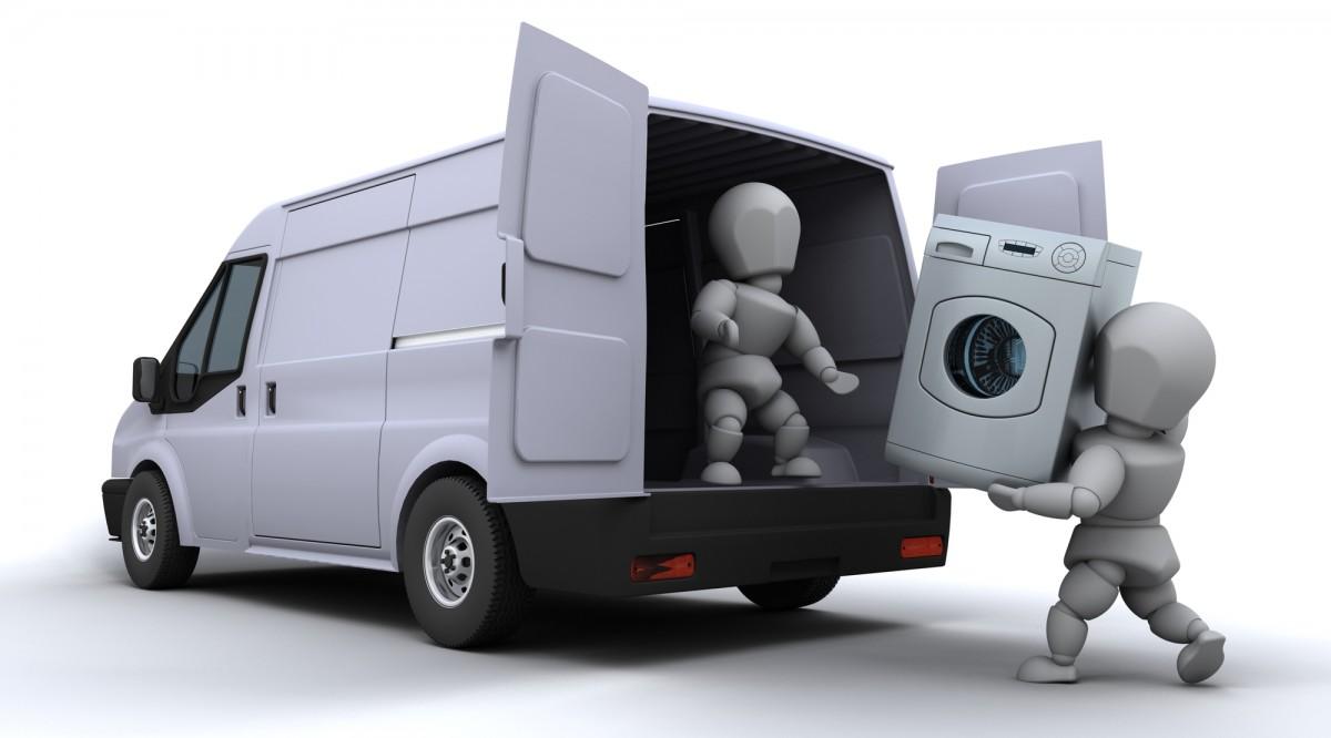 洗濯機を運ぶ引越し業者