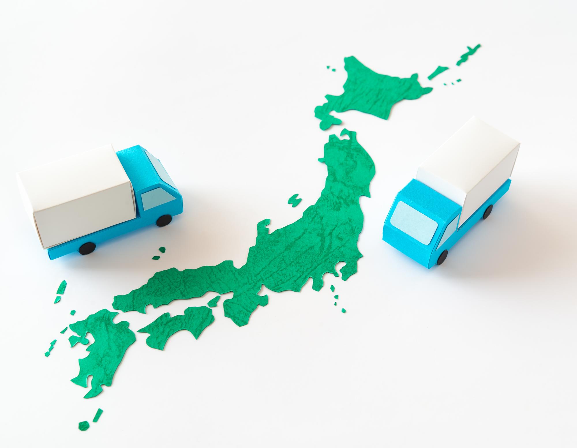 日本地図とトラックのイメージ